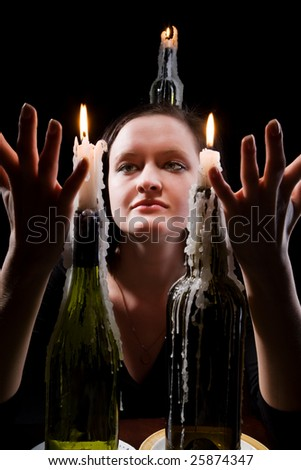 Women with candles on a black background. - stock photo
