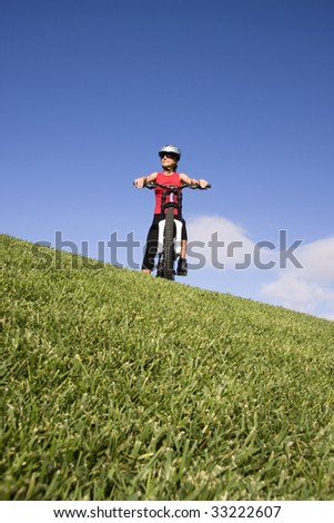 Women with mountain bicycle on the top of a hill