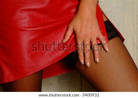 women with red miniskirt and black suspenders to argue the hand on our thigh