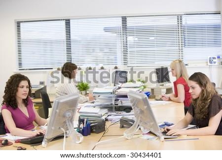 Women working in an office - stock photo
