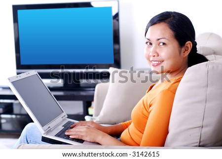 Women working on laptop in the living room