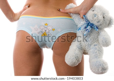 Womens bottom with soft toy.