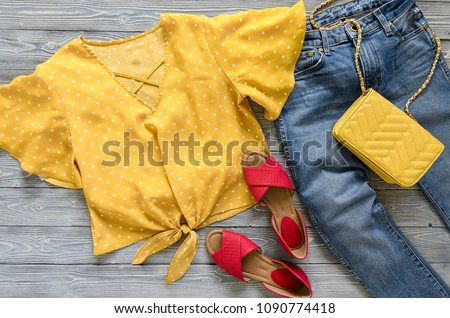 Womens clothing, accessories, shoes (yellow blouse in polka dot, blue jeans, leather red sandals,  yellow crossbody bag). Fashion outfit. Shopping concept. Flat lay. Trendy, saturated colors.  #1090774418