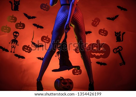 Womens clothing store celebrates Halloween. Sexy Horror background. Halloween sexy concept. Female with sexy ass posing. Sexy Model Posing In Lingerie on halloween background