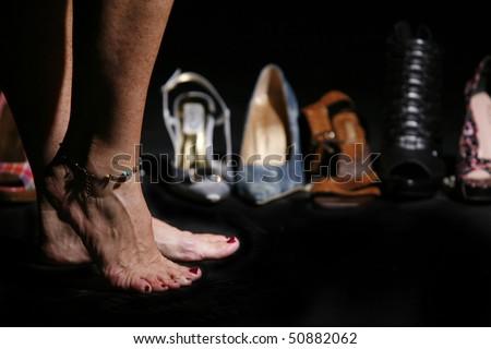 womens feet near lots of shoes