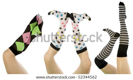 Womens legs up in the air in different socks and different positions.  White background