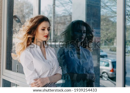 Womens Mental Health. Anxiety Panic Disorders. Bipolar Disorder. Outdoor portrait of Young sad woman and her dark reflection in the mirror window