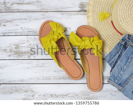 Photo of  Womens shoes (yellow leather sandals with knotted bow). Fashion outfit, spring summer collection. Shopping concept. Flat lay, view from above