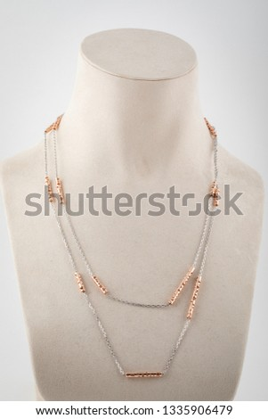 Womens silver double chain  with gold inserts on white mannequin