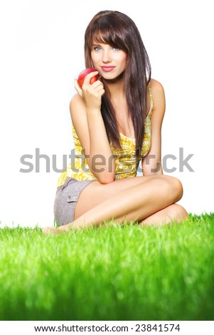 Womna holding apple. shoot on grass on isolated white background