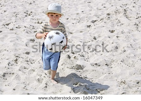 Wonder years. Little player on a beach.