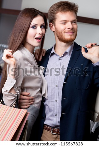 Wondered woman with her pleased boyfriend is in the shop