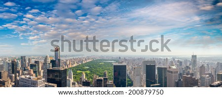 Wonderful aerial view of Central Park and Manhattan skyline on a sunny day - New York City.