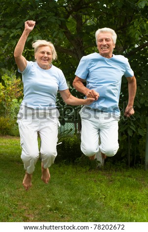 wonderful aged couple smiling and jumping at nature