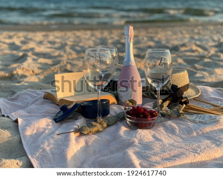 Wonderful beach picknick with berries and rose Stockfoto ©