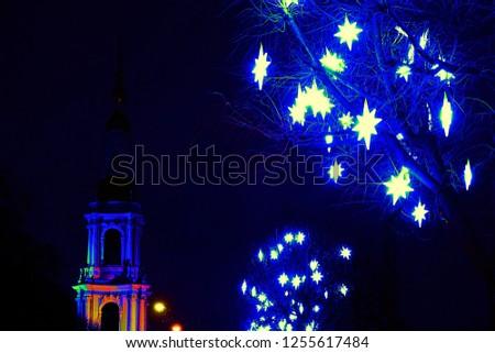 Wonderful Christmas. The Stars of Bethlehem on the streets encouraging residents - guiding star, guiding light #1255617484
