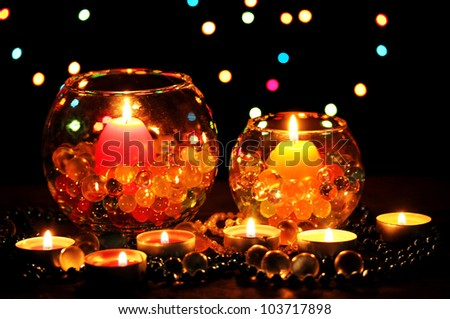 Wonderful composition of candles on wooden table on bright background