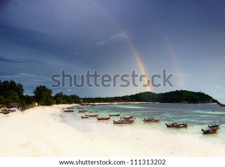 Wonderful double rainbow over the tropical island in Thailand.