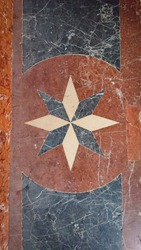 Wonderful floor of white, red, pink, black marble stacked in geometric shapes