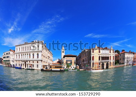Wonderful holiday in Venice. Ornate facades of ancient palaces lit setting sun. Grand Canal water glows.  Photo making the lens Fisheye