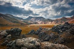 Wonderful icelandic nature. Rocky land, high mountains, dramatic sky. (Iceland)
