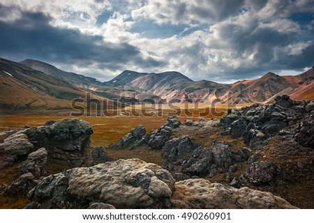 Stock Photo Wonderful icelandic nature. Rocky land, high mountains, dramatic sky. (Iceland)