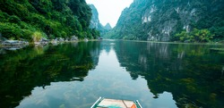 Wonderful landscape in Ninh Binh, Vietnam. Spectacular landscape in Ninh Binh with mountains, caves, river, reflection. Famous natural landscape in Trang An, Vietnam