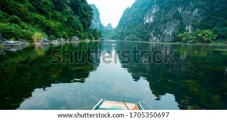 Wonderful landscape in Ninh Binh, Vietnam. Spectacular landscape in Ninh Binh with mountains, caves, river, reflection. Famous natural landscape in Trang An, Vietnam