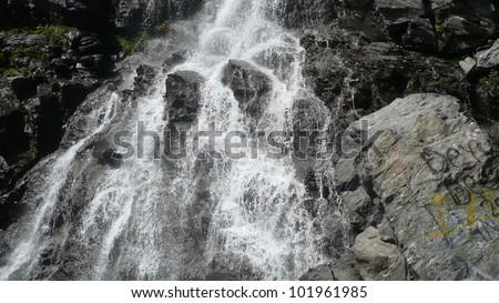 Wonderful landscape Small mountain waterfall rushing over the rocks
