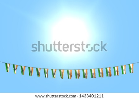 wonderful many India flags or banners hangs on string on blue sky background - any celebration flag 3d illustration