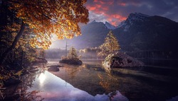 Wonderful morning scenery. Stunning mountains landscape. Scenic image of Hintersee lake during sunset. Popular travel and hiking destination. Picture of wild area. Awesome Background of nature.