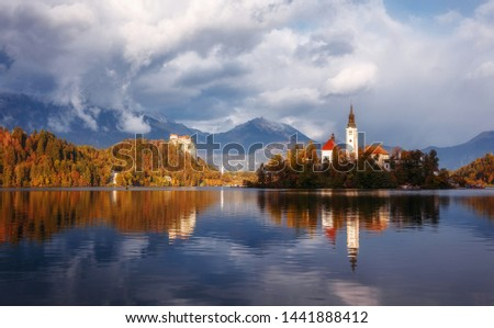 Wonderful Nature landscape. Great view of Famouse Bled Lake in summer day. Amazing Sunny Scenery with fairy tale lake during sunset. Julian Alps. Slovenia. Popular Travel destinations #1441888412