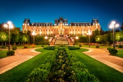 Wonderful night view of Cultural Palace Iasi. Fantastic summer cityscape of Iasi town, capital of  Moldavia region, Romania, Europe. Architecture traveling background.