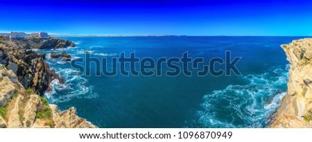 Wonderful romantic panoramic landscape. Coastline of island Baleal of the Atlantic ocean near Peniche. Famous geological sediments sandstone tilts rocks. West coast of Portugal at sunny weather.