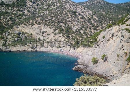 Wonderful seascape with a rocky coast of the Black Sea in Crimea and a view of Cape Karaul-Oba. Bright and sunny summer in Crimea, Russia