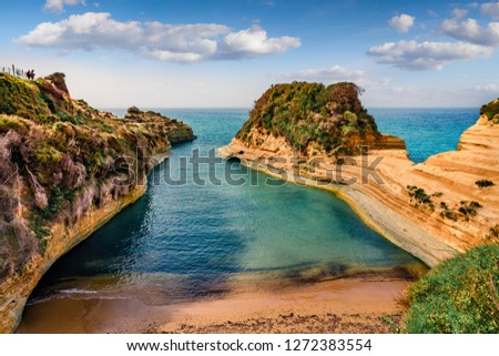 Photo of  Wonderful spring view of famous Channel Of Love (Canal d'Amour) beach. Bright morning seascape of Ionian Sea. Amazing outdoor scene of Corfu Island, Greece, Europe.