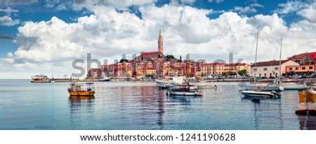 Wonderful summer cityscape of Rovinj town, Croatian fishing port on the west coast of the Istrian peninsula. Panoramic morning seascape of Adriatic Sea. Traveling concept background.