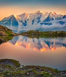 Wonderful summer sunset on Lac Blanc lake with Mont Blanc (Monte Bianco) on background, Chamonix location. Magnificent outdoor scene of Vallon de Berard Nature Preserve, Graian Alps, France.