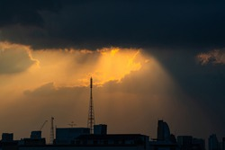 Wonderful Sun Set Light Beam in the city, the light illuminate between the telecommunication tower which can be use for implicating to the strength of mobile phone signal for the telecom operator