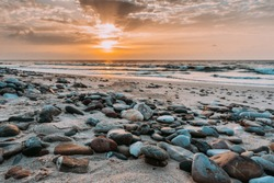 Wonderful sunrise on the beach in Oman near Raz al Jinz, turtle reserve. Landscape of Oman and Arabian Sea.