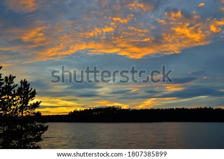 Wonderful sunset on lake Keret, Northern Karelia, Russia Stock fotó ©