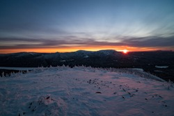 Wonderful sunset over Choc-Chocs mountains, calm skies, winter and snow covered summit, Gaspesie, Qc, Canada