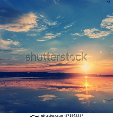 Shutterstock wonderful sunset over the lake. instagram filter
