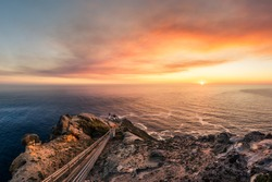 Wonderful sunset over the ocean at Point Reyes Lighthouse near San Francisco California. Path to the lighthouse. Sunset over the water with lighthouse. Landscape photo with sunset.