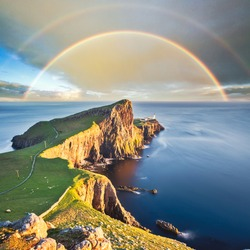 Wonderful sunset with rainbow at the Neist point lighthouse in Scotland