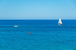 Wonderful view of blue Mediterranean Sea in Puglia, South Italy, with various boats, sailboat, motorboat and dinghy