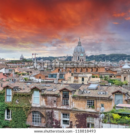 Wonderful view of Rome at sunset with St Peter Cathedral.