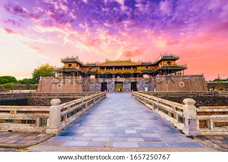 """Photo of  Wonderful view of the """" Meridian Gate Hue """" to the Imperial City with the Purple Forbidden City within the Citadel in Hue, Vietnam. Imperial Royal Palace of Nguyen dynasty in Hue. Hue is a popular"""