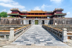Wonderful view of the Meridian Gate to the Imperial City with the Purple Forbidden City within the Citadel in Hue, Vietnam. Hue is a popular tourist destination of Asia.