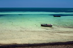 Wonderful views of the Mediterranean coast with birch water, white sand beach and a fishing boat